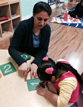 teacher teaching young girl