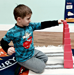 young boy holding blocks